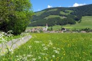 Idyllic alpine meadow and village in Val Badia