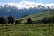 Walking trail in the Valle d'Aosta with view to the snow-capped Alps