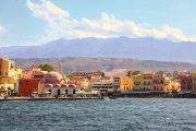 The old town of Chania with view to the mountains of Western Crete behind