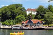 The paddle steamer 'Hjejlen' and a canoe in Silkeborg