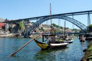 The Dom Luis bridge and traditional Rabelo boats in Porto