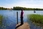 Enjoying the view over the lake Tange Sø from a small jetty