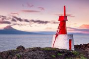 Windmill on Sao Jorge island in the Azores with view across the ocean to Pico island
