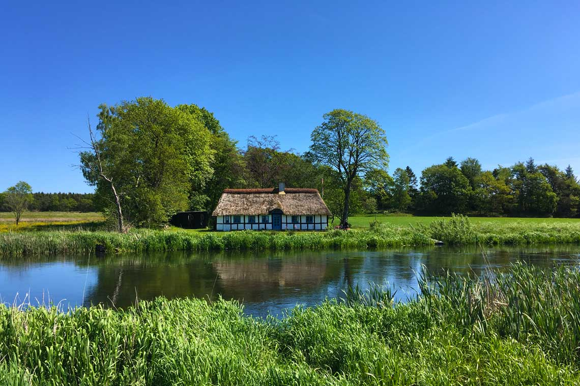 Thatched cottage on the banks of Gudenåen