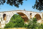 Crossing a medieval bridge in the Luberon