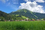 Alpine meadow and village along the Lechweg